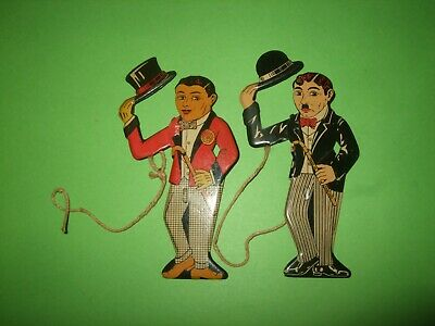Two Old Tinplate Figures Of Charlie Chaplin And Other. • 16£