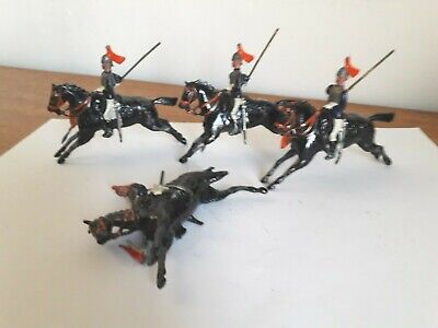 Four Vintage Britains Lead Toy Mounted Soldiers.  • 9.50£