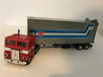 Vintage Optimus Prime (Used Condition) Has Fists And Spring Loaded Car!!! • 5£