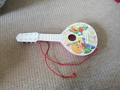Toy Guitar • 3£