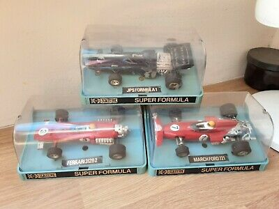 SCALEXTRIC F1 SLOT CARS  X 3 ,BOXED,  JPS , FERRARI & MARCH FORD   • 23.22£