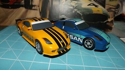 SCALEXTRIC 2 X NISSAN 350z DIGITAL Cars - Complete - Rare ! • 29.99£
