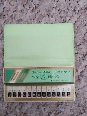 Electron Echo Mini Piano With Song Book - 1980s • 8.50£