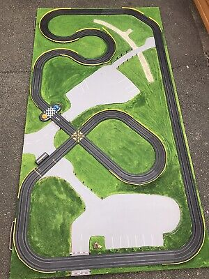 Micro Scalextric Track On A Base Board With Cars • 99£